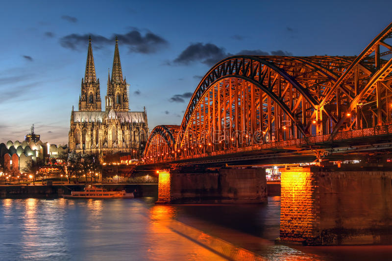 Cologne Koln, Germany. Sunset scene in Cologne Koln in North Rhine Westphalia region of Germany, surprising the Cologne Cathedral Kolner Dom and the Hohenzaller stock photo
