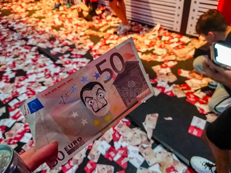 COLOGNE, NORTH RHINE-WESTPHALIA, GERMANY - AUGUST 24, 2019 A false bill at the Netflix booth at Gamescom 2019 at La casa papel - stock photography