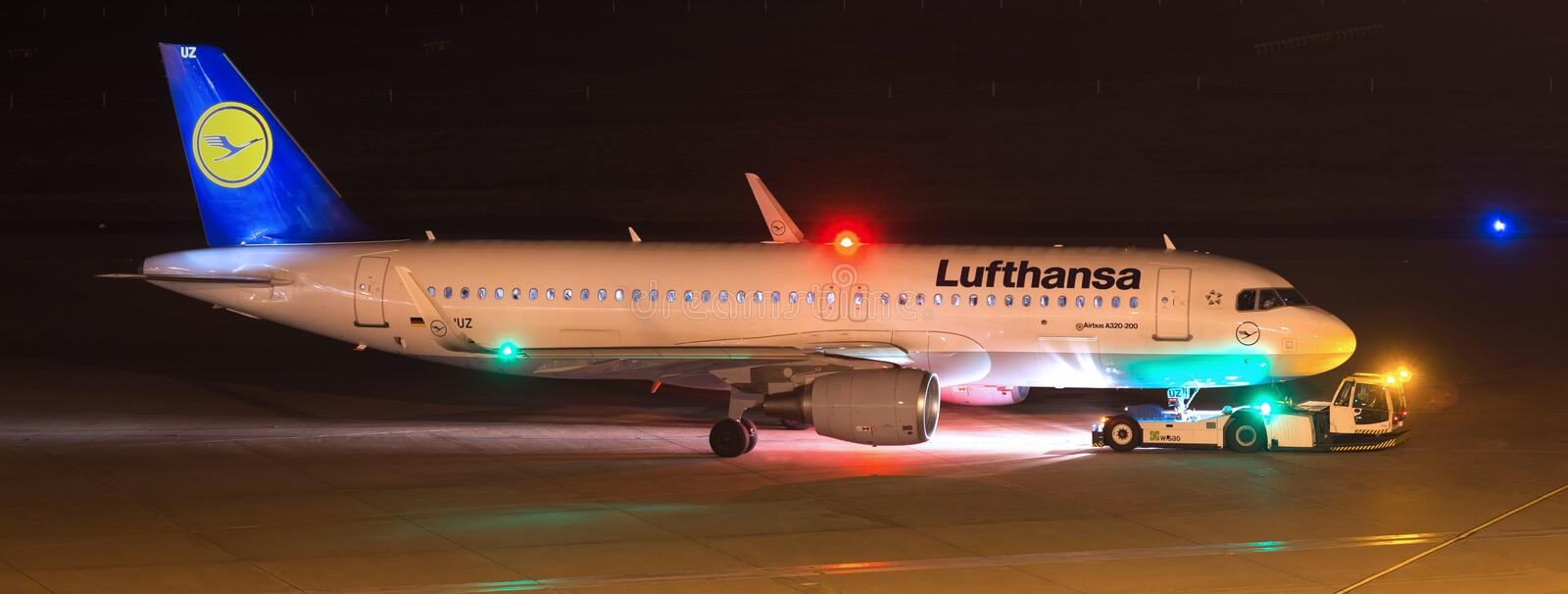 Lufthansa airplane at airport cologne bonn germany at night. Cologne, North Rhine-Westphalia/germany - 02 01 19: lufthansa airplane at airport cologne bonn royalty free stock photography