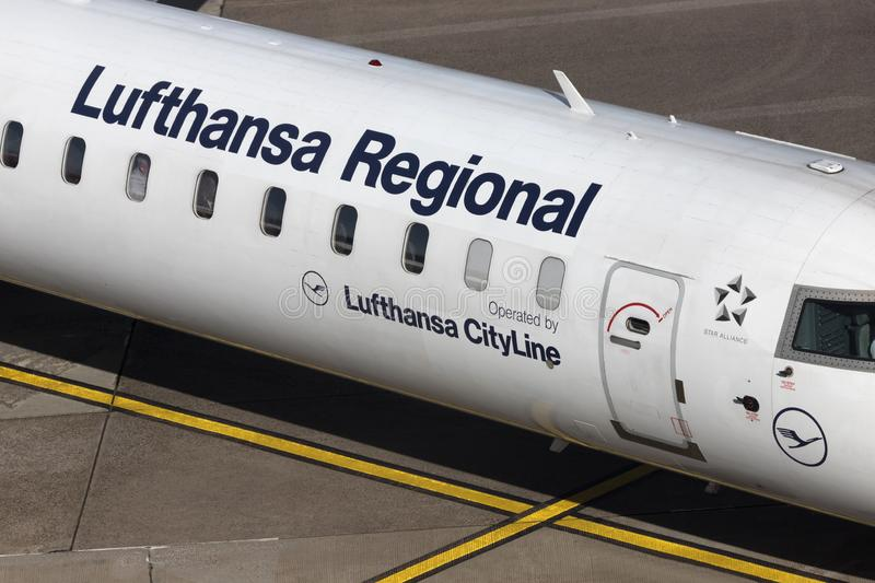 Lufthansa regional airplane at cologne bonn airport germany. Cologne, nrw/germany - 14 10 19: a lufthansa regional airplane at cologne bonn airport germany royalty free stock photos