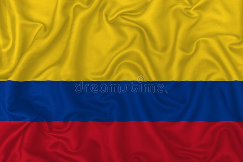 Colombia country flag. On wavy silk textile fabric background vector illustration