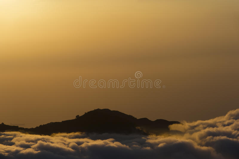 Colombia - peak in clouds at sunset. In the Area Sierra Nevada de Santa Marta, a District in the north of colombia stock image
