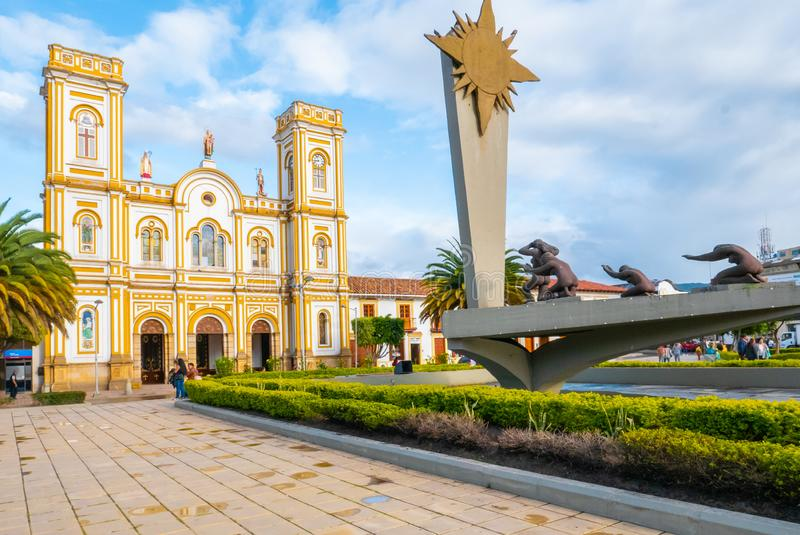 Colombia Sogamoso  Saint Martín of Tours cathedral and sun monument at sunset. Sogamoso, Colombia  May 23 Saint Martin Church and Sun monument located in stock images