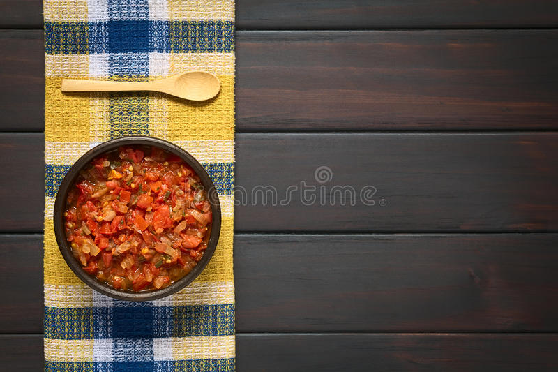 Colombian Hogao Sauce. Overhead shot of Colombian hogao or criollo sauce (salsa criolla) made of cooked onion and tomato, served as accompaniment to traditional royalty free stock photo