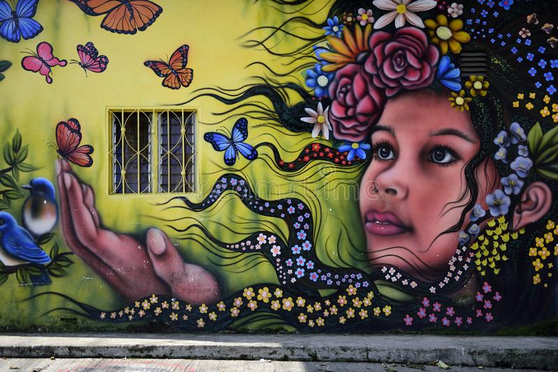 Colorful community mural, street art, girl and butterflies royalty free stock image