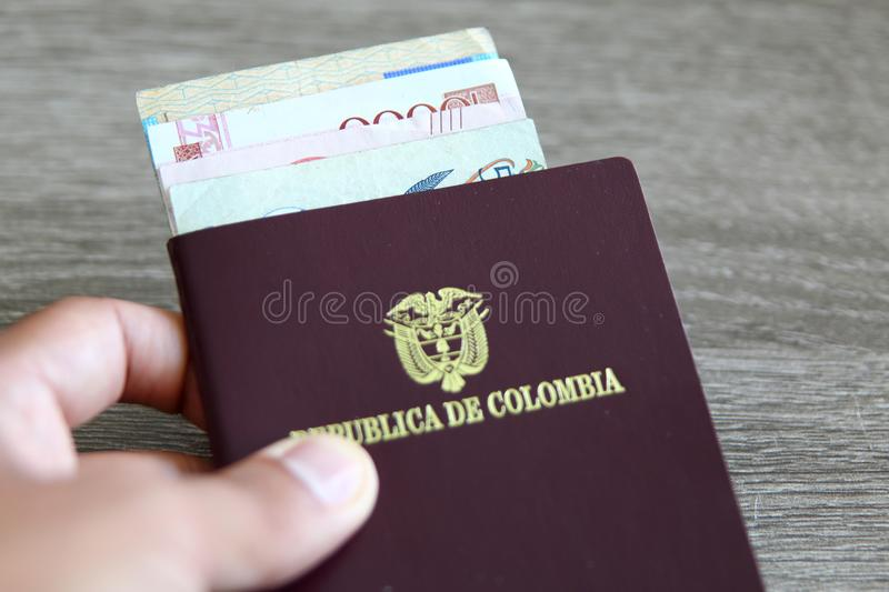 Colombian passport with bank notes royalty free stock image