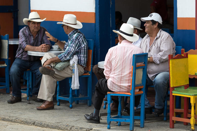 Colombian people. October 2, 2016 El Jardin, Colombia: men relaxing in front of a coffee house in the small tourist destination town royalty free stock photo