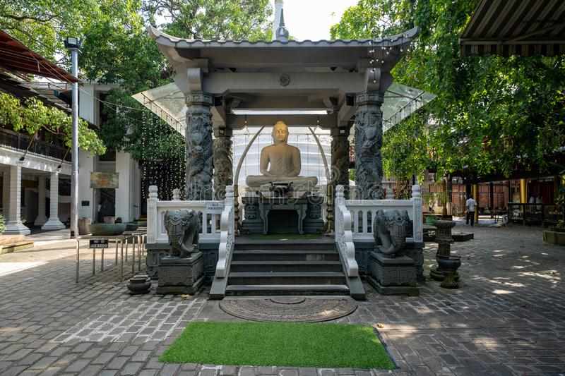 Colombo, Sri Lanka - November 19, 2019: The Gangaramaya Buddhist Temple with large jade Buddha statue and shrine stock photo