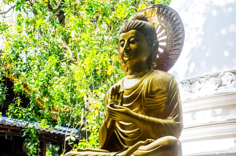 Colombo/Srilanka December 2019: Golden Buddha statue in Gangaramaya Temple in Colombo, Srilanka. Colombo/Srilanka December 27th 2019: Golden Buddha statue in stock image