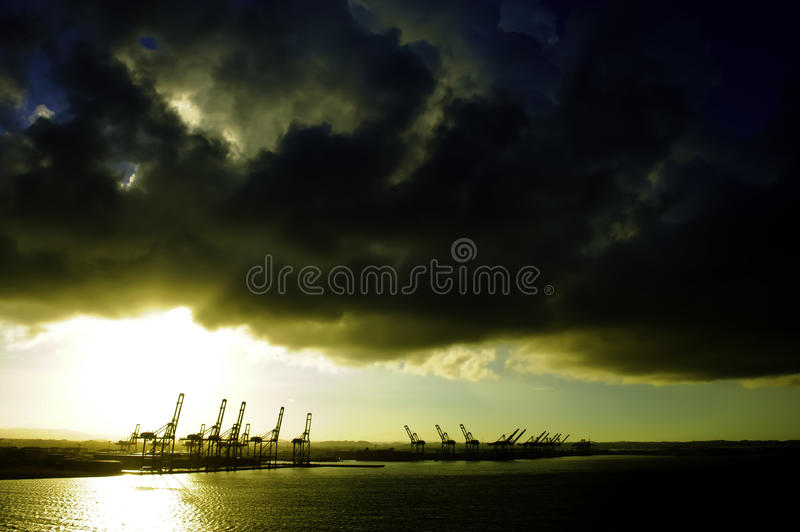 Colon Panama. Cranes at the port of colon, panama, at sunrise royalty free stock image