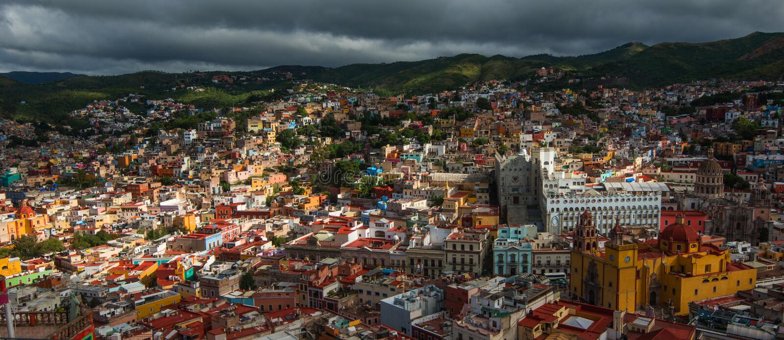 Colonial colorful traditional city and buildings of silver mining age in hill, Guanajuato, Mexico, American. Colonial colorful crowd city and buildings of silver stock images