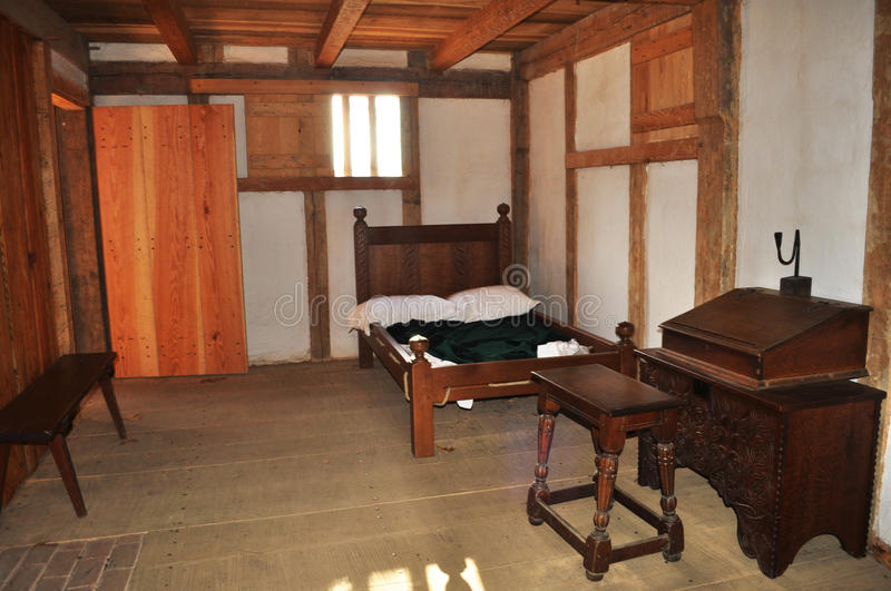 Colonial Era Bedroom. An image of a colonial era bedroom taken at the Jamestown Settlement in Williamsburg Virginia royalty free stock image