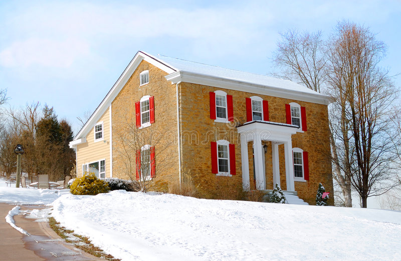 Colonial Farmhouse in Winter royalty free stock photography