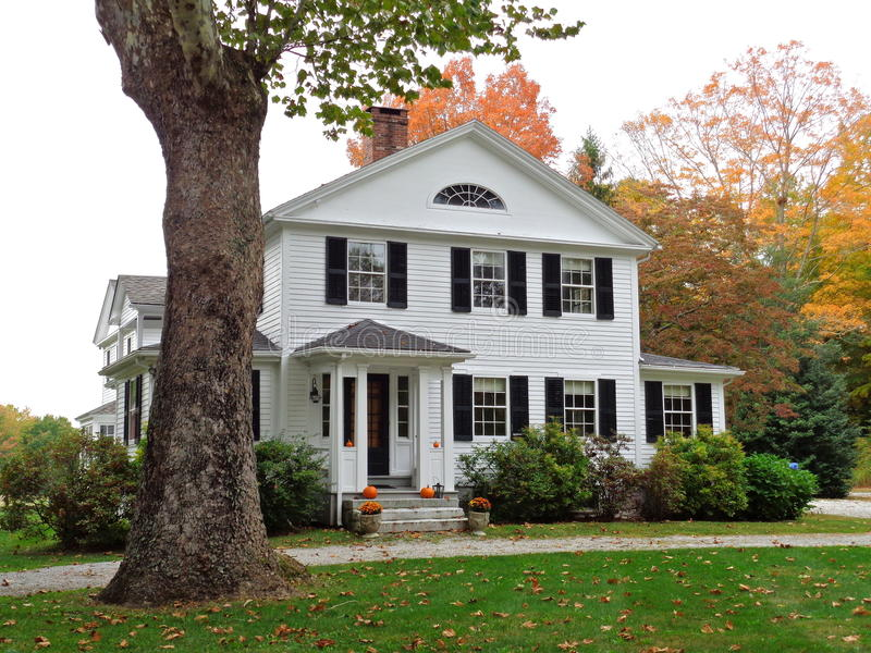 Colonial home in Connecticut with fall colors royalty free stock photography