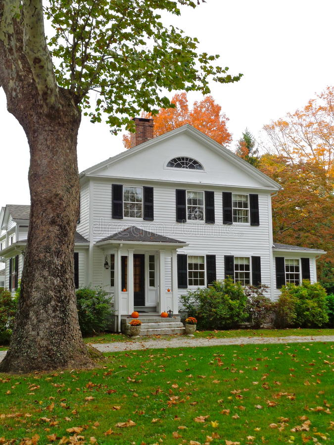 Colonial home in Connecticut with fall colors stock photography