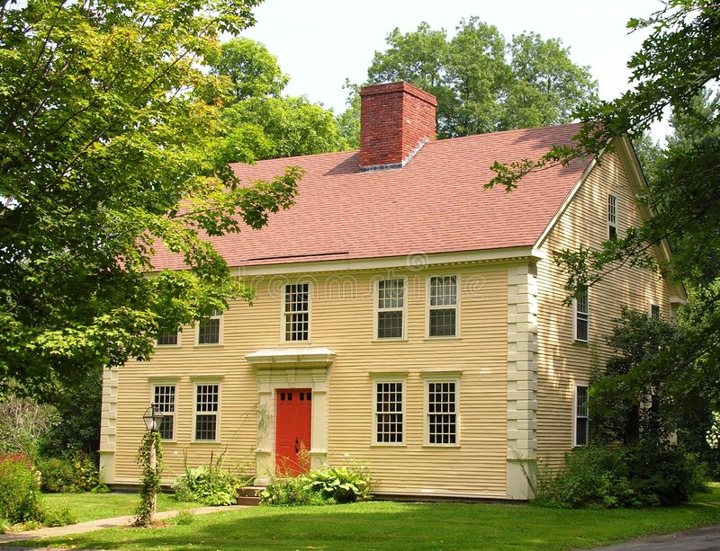 Colonial Home in Village. stock photography