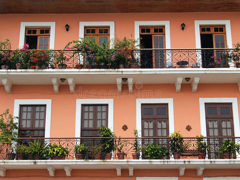 Colonial house balcony with flowers and plants royalty free stock photo