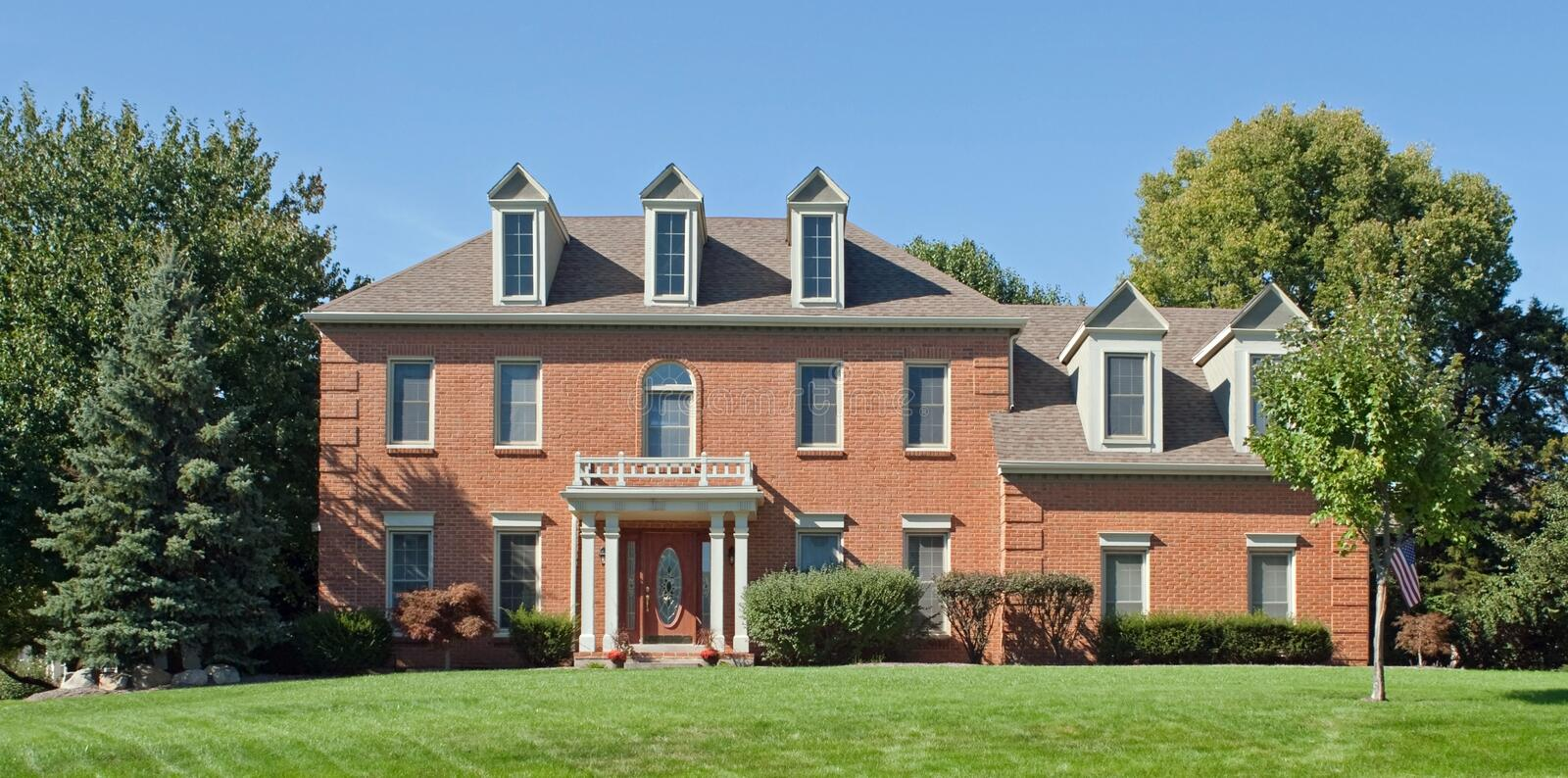 Colonial House. Large, Colonial-style house in Midwest suburbs stock photos