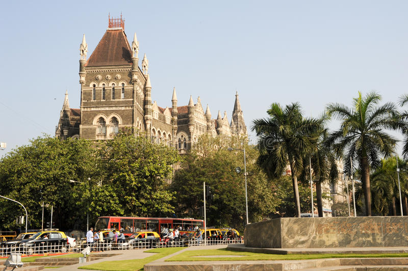 Colonial Oriental Building on famous square in Mumbai. Mumbai, India - 5 january 2015: People in the traffic in front of the colonial Oriental Building at Mumbai stock image