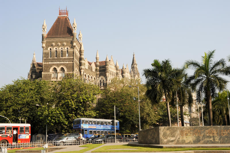 Colonial Oriental Building on famous square in Mumbai. Mumbai, India - 5 january 2015: People in the traffic in front of the colonial Oriental Building at Mumbai royalty free stock images