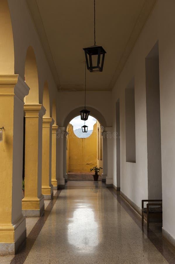 Colonial patio in Trinidad, Cuba, hall, columns, inside building stock photos