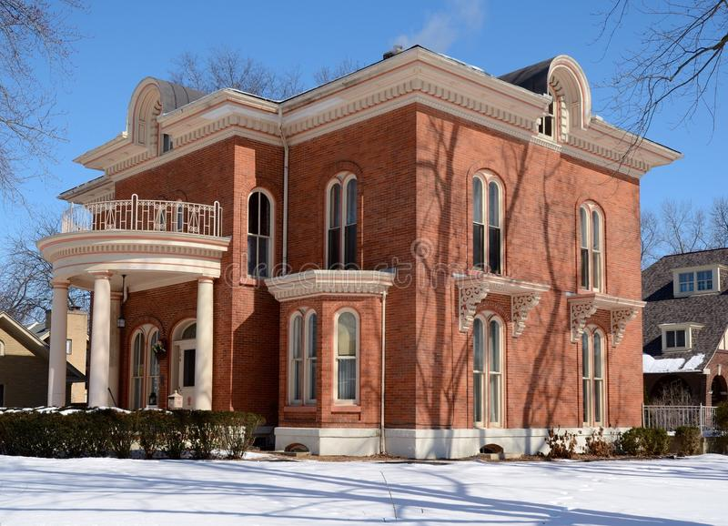 Colonial in Snow. This is a Winter picture of a brick home in Ottawa, Illinois. This home built in 1869 is an example of the Colonial Revival of architecture royalty free stock image