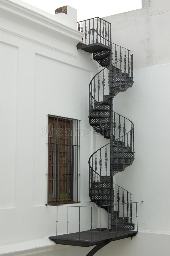 Colonial spiral staircase stock images