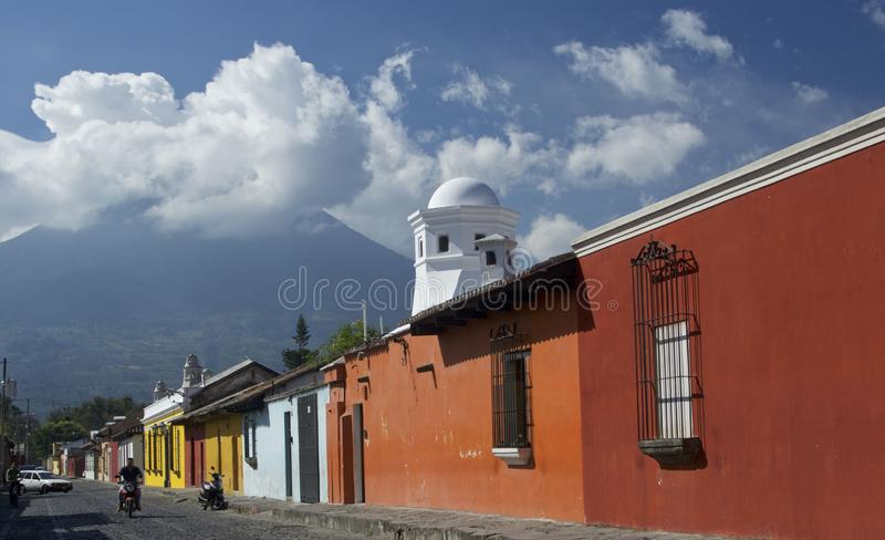 Colonial street with colorful houses. Antigua. Guatemala. Typical colonial street with painted houses in Antig-ua, Guatemala with volcano in the background. The royalty free stock photography