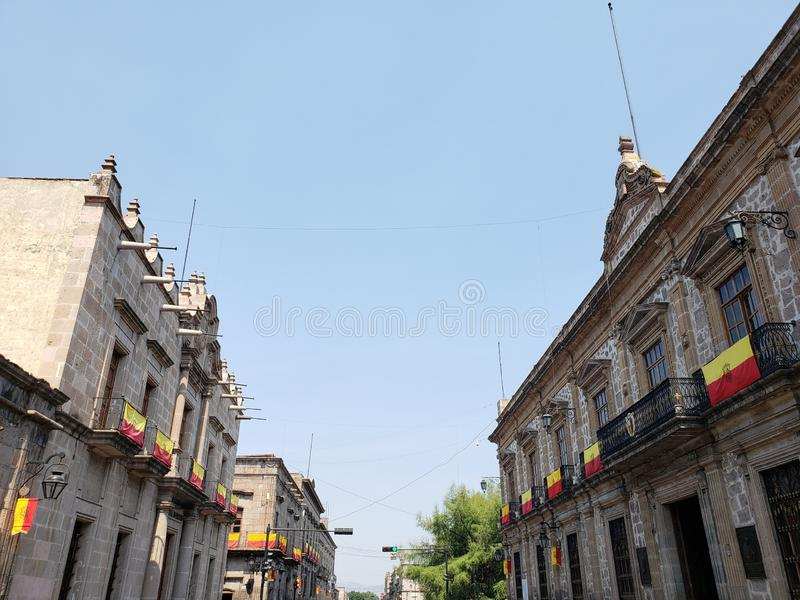 Colonial style architecture in the city of Morelia, Mexico. Old, antique, traditional, street, outdoor, building, history, historic, culture, town, blue, sky royalty free stock image