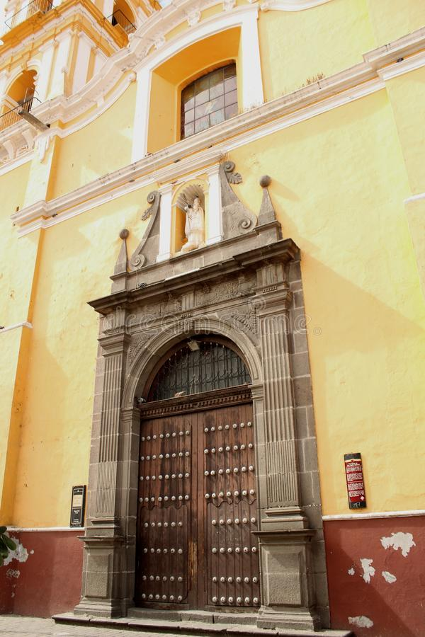 Colonial style door in Mexico. This is the legacy of the mixture of cultures, between the Spaniards and the natives of Mexico, which resulted in a conquest that stock image