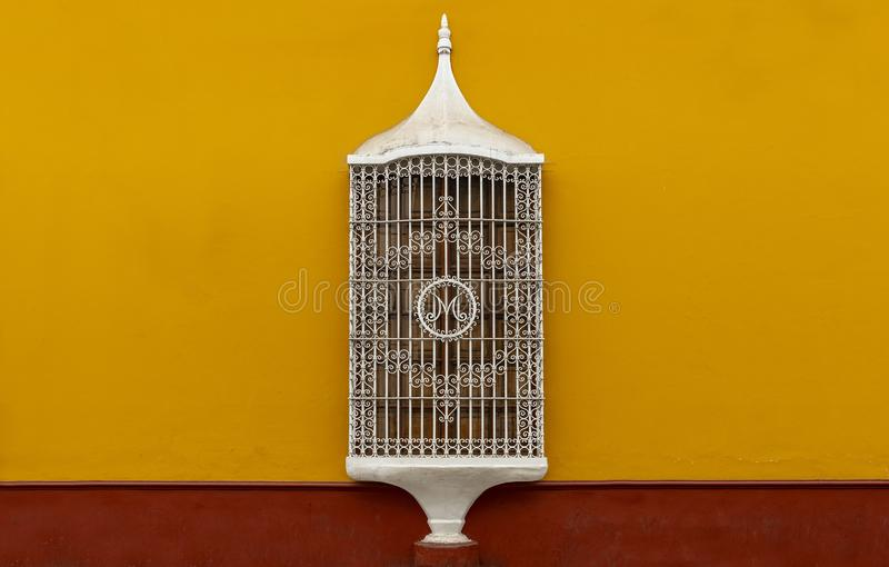 Colonial Style Window Architecture, Trujillo, Peru. An example of cast iron architecture decorations used in the colonial style windows in the historic city stock image