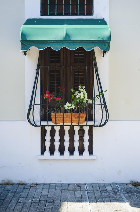 Colonial window with iron bars with limestone wall. Is typical of the houses in the colonial area of Santo Domingo stock images