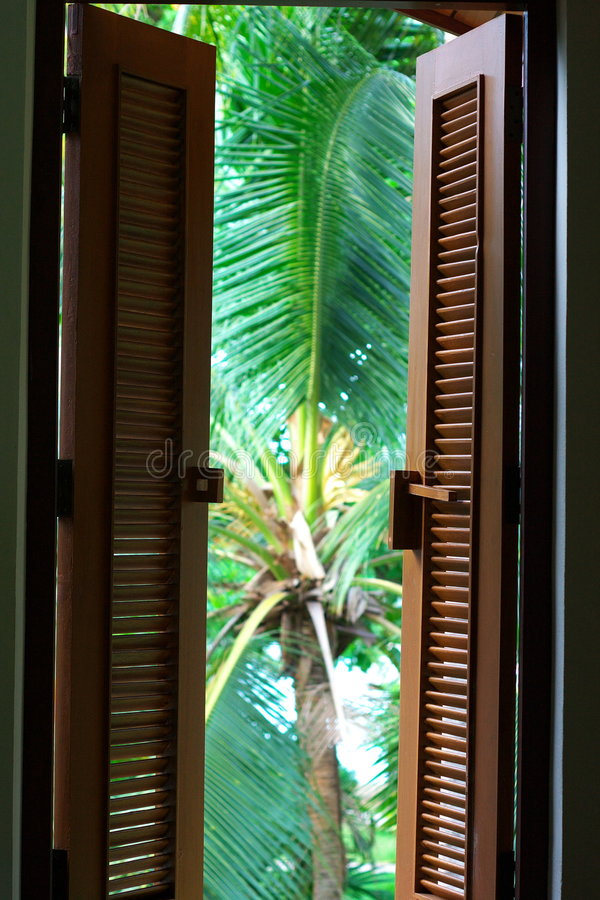 Colonial window shutters stock photography