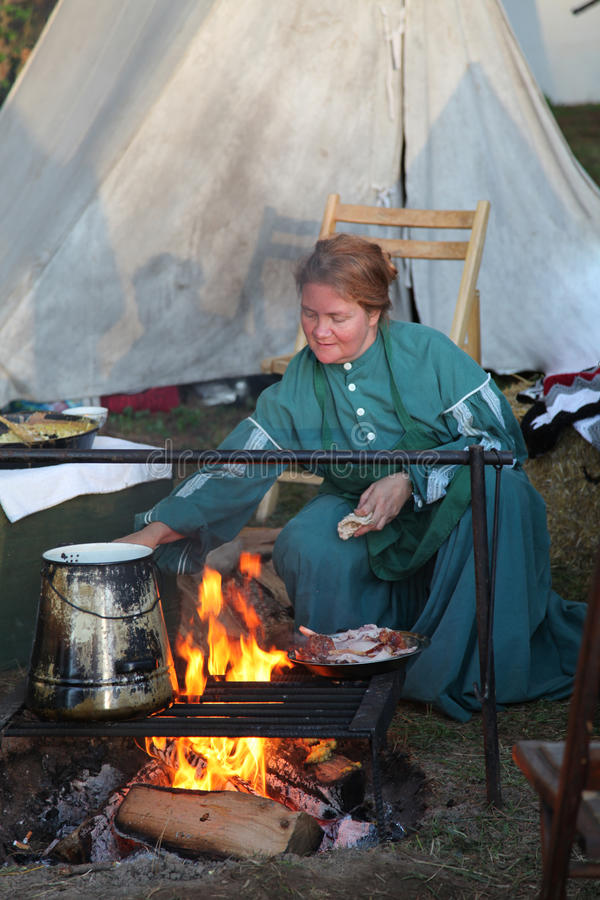 Free Colonial Woman Cooking Over A Fire Stock Image - 56691671