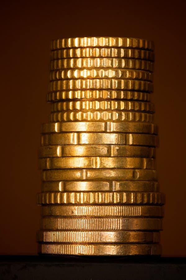 Colonna di soldi dorati immagini stock libere da diritti