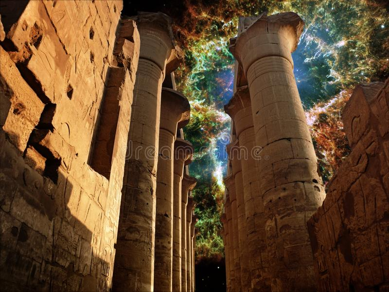 Colonnade in the Luxor Temple and the Crab Nebula (Elements of t royalty free stock image