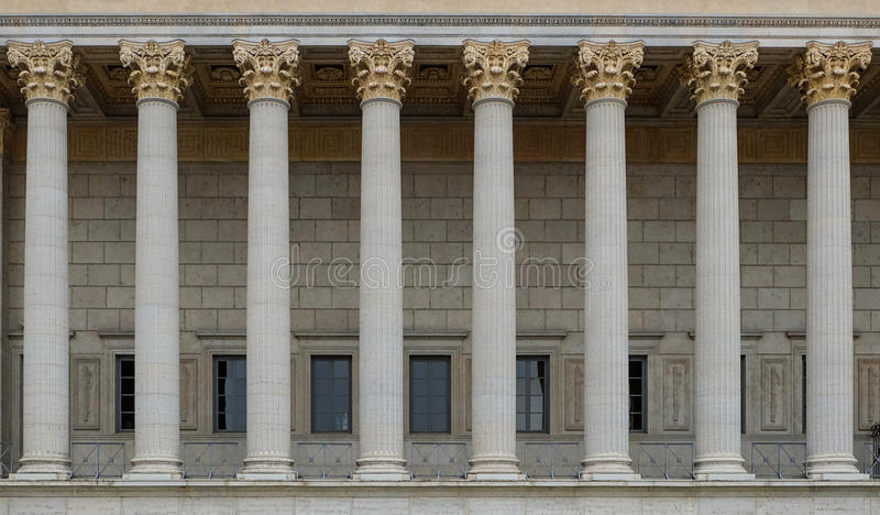 A colonnade of a public law court. A neoclassical building with a row of corinthian columns. The colonnade / row of columns in the style of neoclassicism stock image