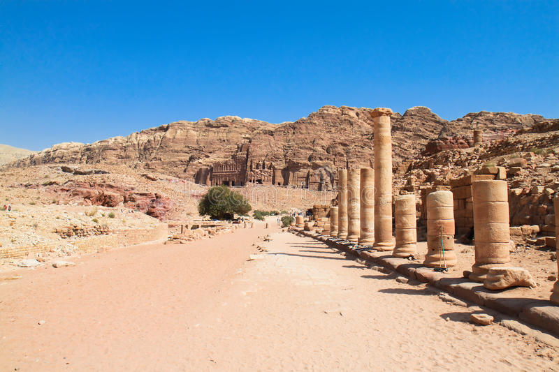 Colonnaded street in ancient city of Petra, Jordan. Street of Facades, riddling the walls of the Outer Siq are over 40 tombs and houses built by the Nabataeans royalty free stock image