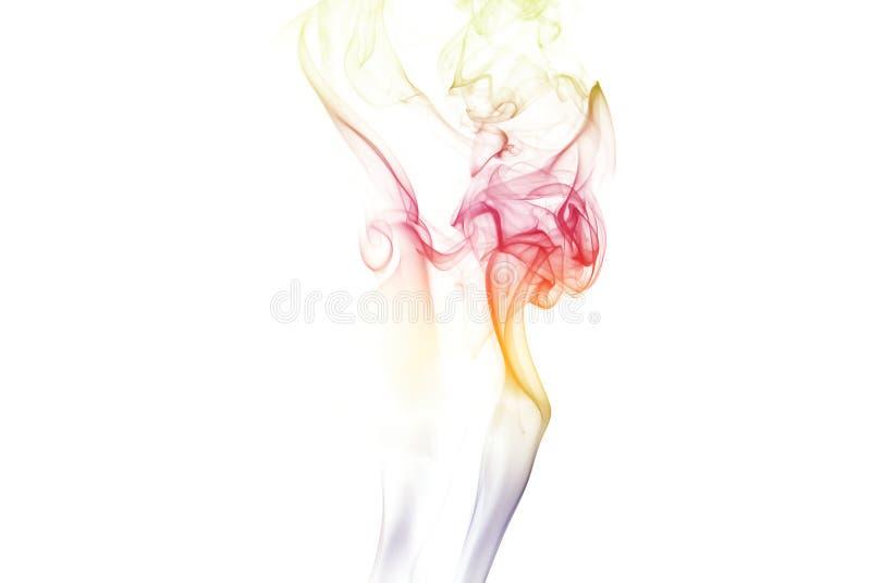 Colonne gemellare colorate del fumo fotografie stock