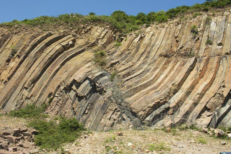 Colonnes hexagonales coudées d'origine volcanique chez Hong Kong Global Geopark en Hong Kong, Chine photographie stock