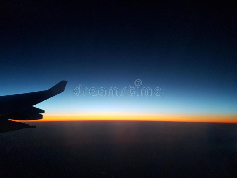 beautiful sunset or sunrise from the sky with airplane wing royalty free stock image