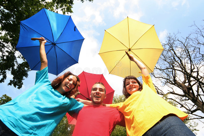 Color. Funny colorful friends with umbrellas royalty free stock images