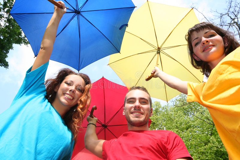 Color. Funny colorful friends with umbrellas stock photography