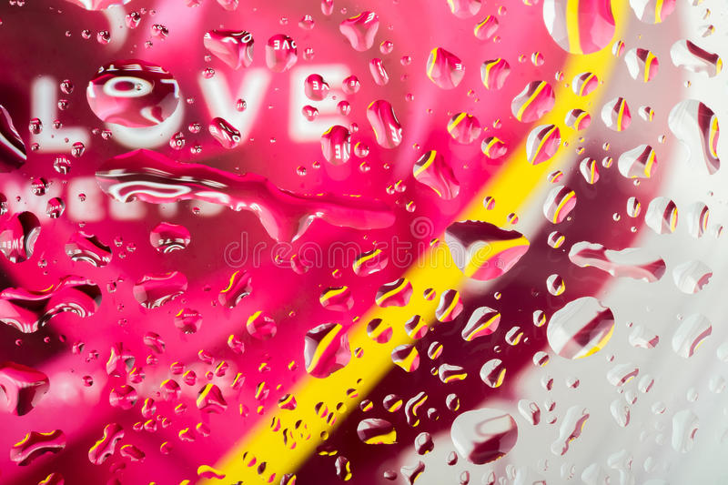 Color abstract love background with water drops. On glass for background or backdrop stock photography