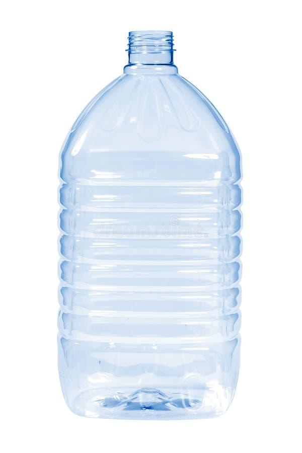 Color azul de la botella plástica nueva, limpia, vacía en el fondo blanco imágenes de archivo libres de regalías
