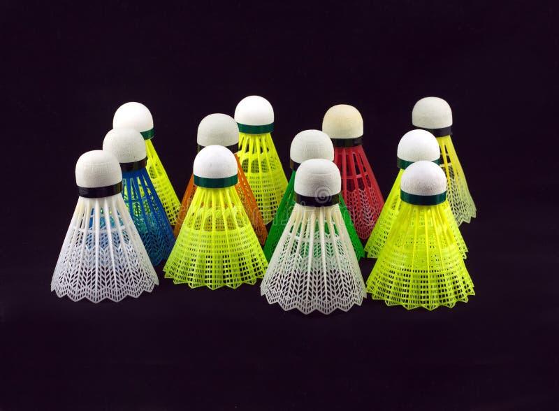 Color badminton shuttlecocks isolated on black royalty free stock photos
