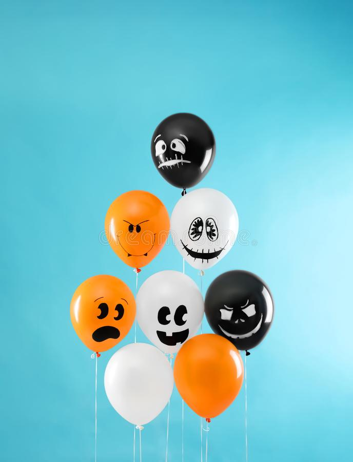 Color balloons for Halloween party on background. Color balloons for Halloween party on blue background stock photos