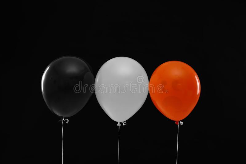 Color balloons for Halloween party on background. Color balloons for Halloween party on black background royalty free stock image
