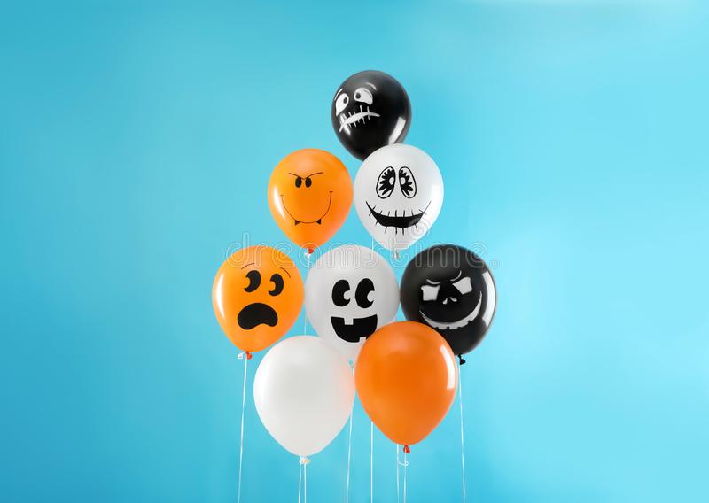 Color balloons for Halloween party on blue. Background royalty free stock image