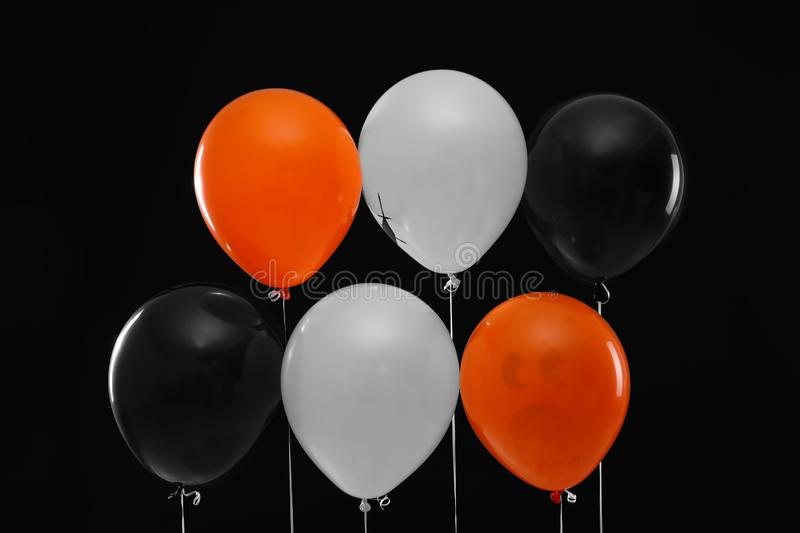 Color balloons for Halloween party. On black background stock image